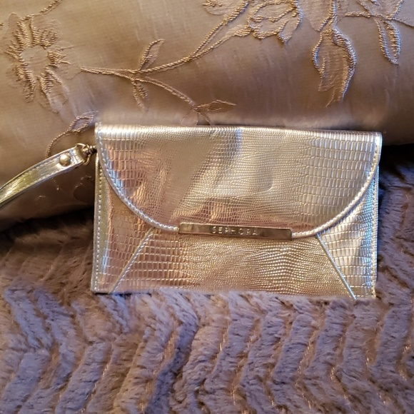 Sephora Handbags - Mini Silver Wristlet